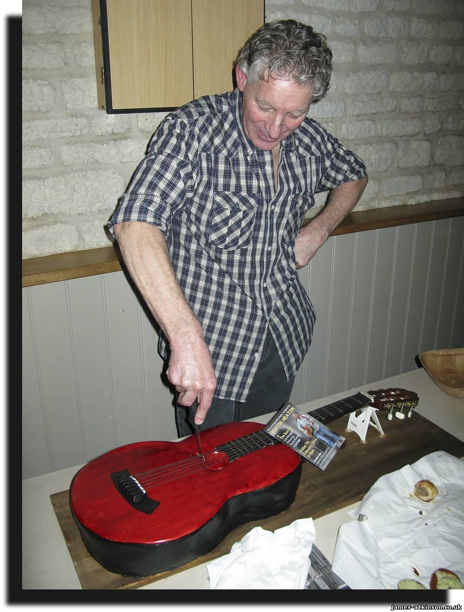 Martin cutting the cake